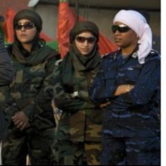 Cinco guardaespaldas de Gadafi le acusan de violarlas