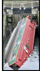 Capsized narrow boat stuck in lock No: 11 in Widcombe  pic by Lloyd Ellington 170314 news
