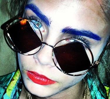 cara blue eyebrows