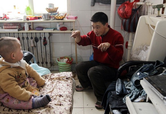 Chinese family of 3 lives in transformed public restroom