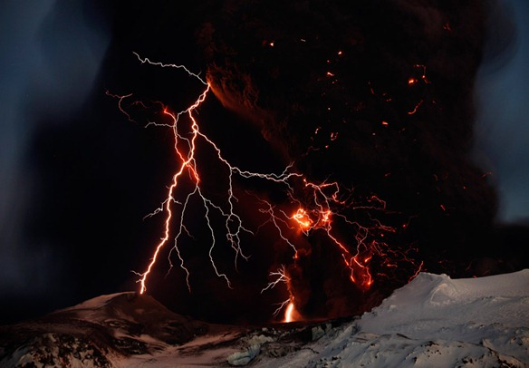 Lightning streaks across the sky as lava flows from a volcano in Eyjafjallajokul April 17, 2010 REUTERS Lucas Jackson