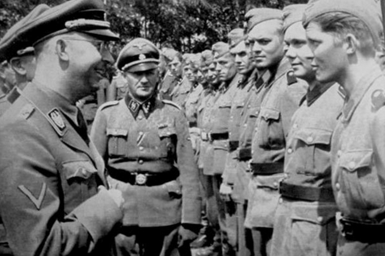 Reichsführer-SS_Heinrich_Himmler_in_1943_inspects_and_chats_with_Swedish_members_of_the_Waffen_SS_(perhaps_from_the_5th_SS_Panzer_Division_Wiking_but_more_likely_from_the_11th_SS_Panzergrenadier_Division_Nordland)