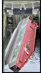 Capsized narrow boat stuck in lock No: 11 in Widcombe  pic by Lloyd Ellington 170314 news